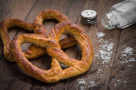 pretzel stick: Pretzels with salt on wooden table Stock Photo
