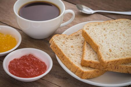 whole wheat bread: Whole wheat bread with jam and a coffee cup Stock Photo