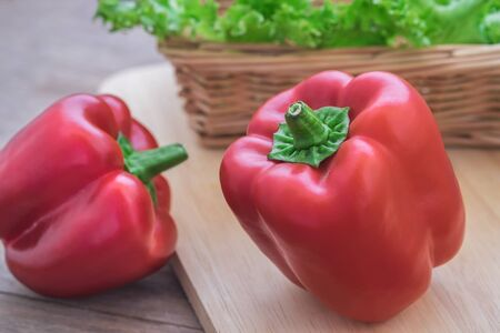 bellpepper: Sweet red pepper on wooden cutting board Stock Photo