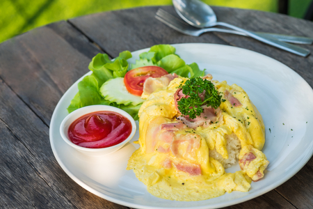 Omelet with bacon and rice on plate