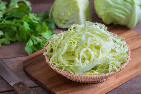 Fresh shredded cabbage in wicker basket