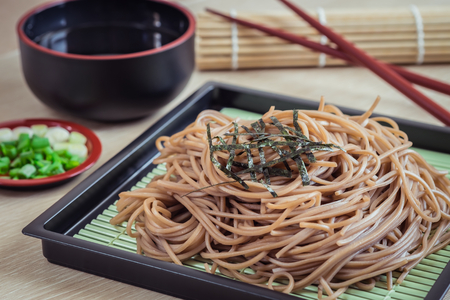Soba noodles with dried seaweed on plate, Japanese food Stock Photo