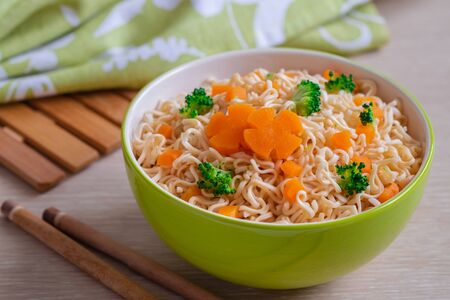 Instant noodle with vegetables in bowl
