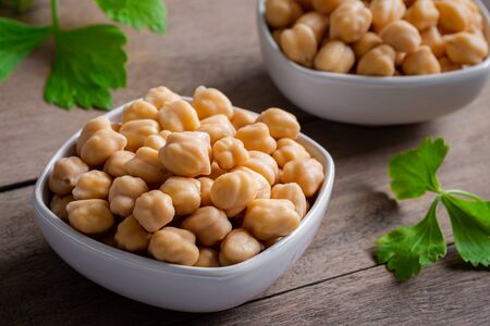 Cooked chick peas in white bowl