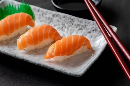 Salmon nigiri sushi on plate, Japanese food