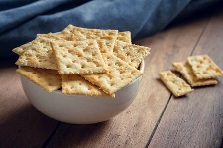 Crispy crackers with sesame in bowl