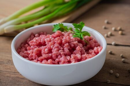 Raw minced pork in white bowl
