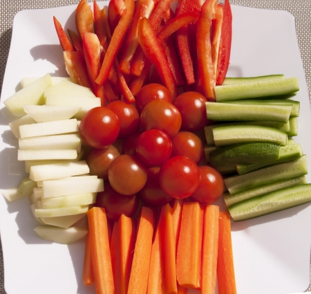 crudite: Closeup of assorted fresh raw vegetables on a white platter Stock Photo