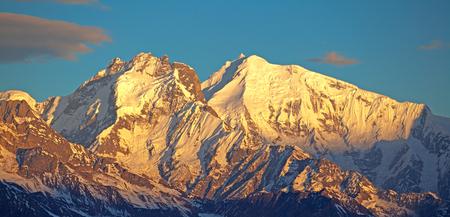Ganesh Himal mountain range in golden light of sunrise. The Himalayas, Langtang, Nepal.