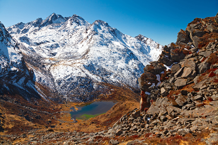 Gosaikunda mountain lake among the snowcapped mountains. The Himalayas, Langtang, Nepal.