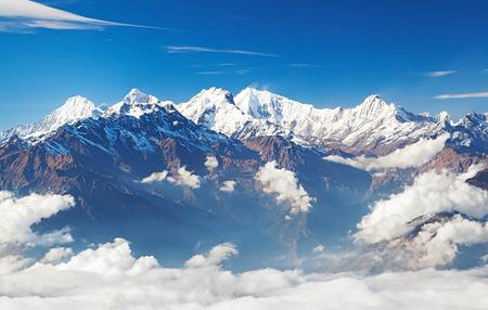 Snowy mountain ridge in clouds - Ganesh Himal and Manaslu Himal mountain range. Himalayas, Langtang, Nepal.