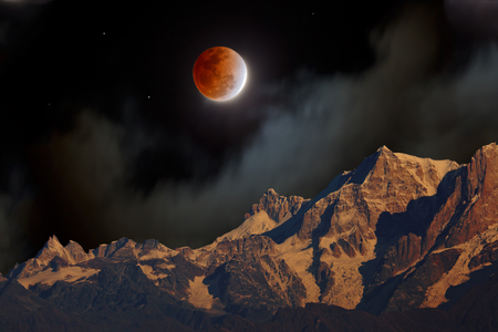 A total lunar eclipse with the red Moon at night in misty clouds over Himalayan mountains.