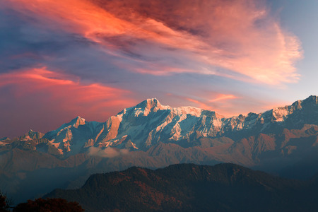 Red sunset sky with cirrostratus clouds over Kedarnath mountain of Gangotri Range in the western Garhwal Himalaya, Uttarakhand, India. View from Chopta village.