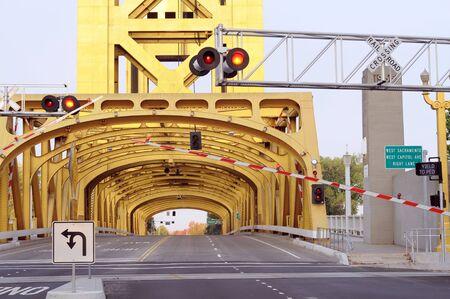 horizontal view of tower bridge, road, railroad stop light