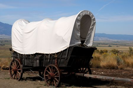 Conestoga wagon replicated against outdoor western hills