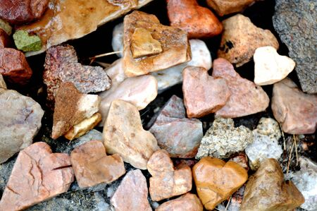 representations: collection of heart-shaped rocks in various natural colors
