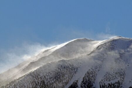 iciness: Cold mountain top surrounded by blowing snow Stock Photo