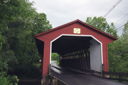 yesteryear: red covered bridge of yesteryear stands in Vermont