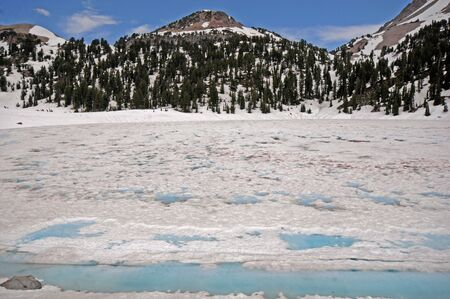 breaking up: Lake ice breaking up in Glacier National Park