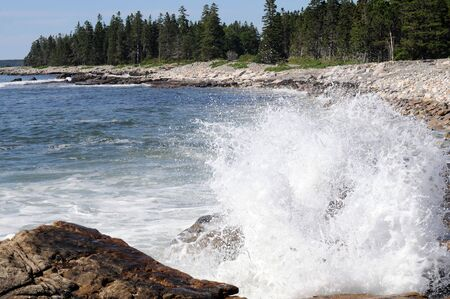 sea water crashes against shore on Maine coast photo