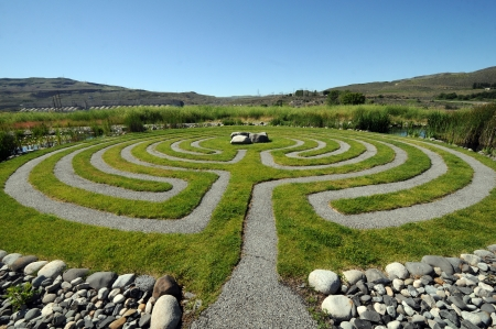 large outdoor gravel and grass labyrinth for meditating
