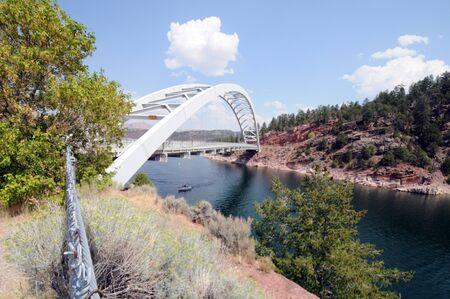 chasm: bridge spanning green-blue Cart Creek at Flaming Gorge, Utah Stock Photo