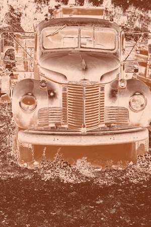 tred: Copper toned photo of old International truck sitting in a ghost town on the outskirts of Jerome, Arizona.