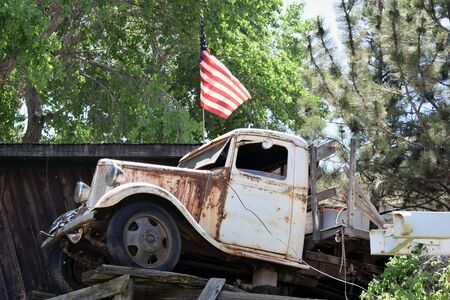 Flag flies above an antique International Truck at the Gold King Mine Ghost Town, once the town of Haynes in Arizona.