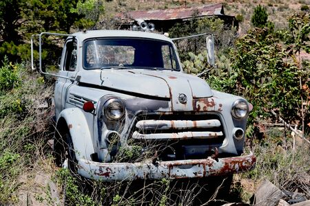 Old junker truck sits among the weeds at the abandoned town of Haynes, Arizona, now a ghost town.