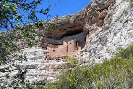 rock formation: Montezuma�s Castle National Monument, Arizona, a cliff dwelling surrounded by trees, was built by early Southern Sinagua farmers. Stock Photo