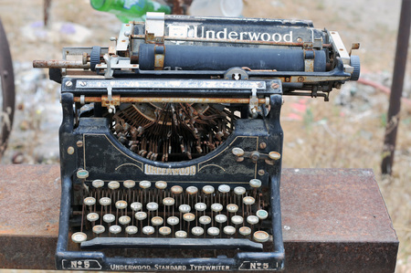 Antiquated Underwood typewriter sitting outside at Elmer's Bottle Tree Ranch, old Route 66, Oro Grande, California.
