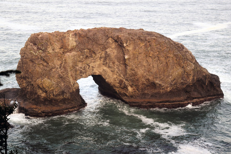 Arch Rock formation, coastal attraction along Oregon's 12-mile Samuel H. Boardman State Scenic Corridor Stock Photo