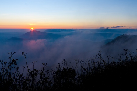 City of the Coast Mountains, The beautiful Sunrise on mist at Phu Ruea National Park, Thailand  photo