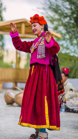 Artists in traditional tibetan costumes performing folk song. in Leh, India.