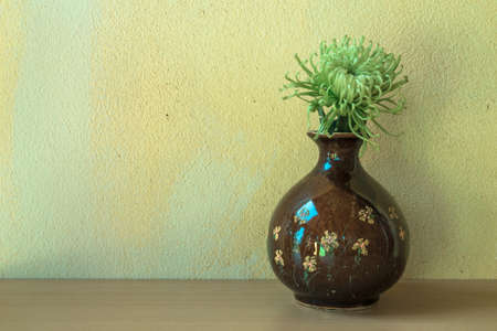 Still life with flower on wooden table and grunge background photo