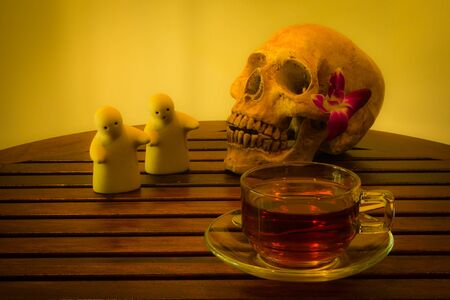 corpse flower: still life with skull and twin doll on tea time Stock Photo