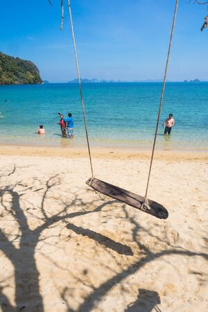 bask: KRABI THAILAND MARCH 2: Many tourists to swimming and bask playfully during the high season in the Andaman sea on 2 March 2015 at KrabiThailand Editorial