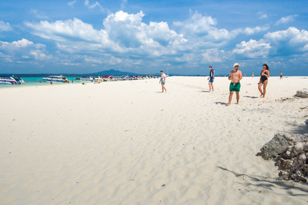 bask: KRABI THAILAND MARCH 1: Many tourists to swimming and bask playfully during the high season in the Andaman sea on 1 March 2015 at Krabi Thailand