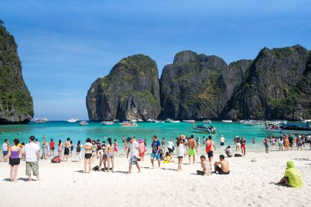 bask: KRABI THAILAND MARCH 1: Many tourists to swimming and bask playfully during the high season in Maya bay on 1 March 2015 at Krabi Thailand Editorial