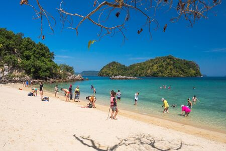 bask: KRABI THAILAND MARCH 2: Many tourists to swimming and bask playfully during the high season in the Andaman sea on 2 March 2015 at Krabi Thailand