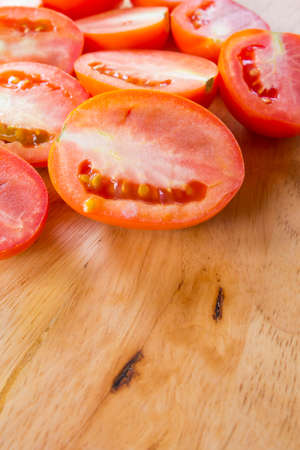 healt: Tomato sliced on wooden background
