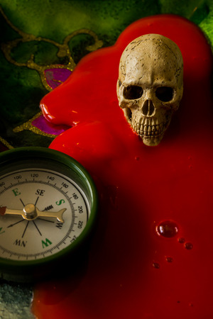 ghost face: still life with skull and compass on abstract background Stock Photo