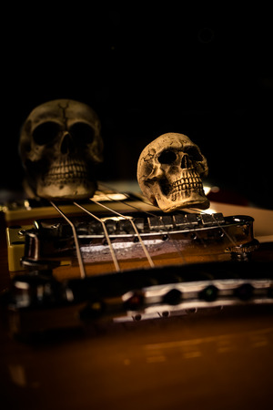 spooky skull: Still life with skull and electric guitar Stock Photo