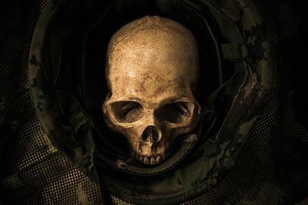 Still life with human skull in soldier helmet