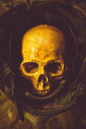 ghost face: Still life with human skull in soldier helmet