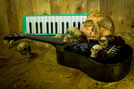 corpse flower: Still life with group of human skull with love music style Stock Photo