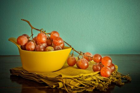 Still life with organic grape on vintage background Stock Photo