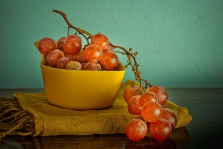 Still life with organic grape on vintage background