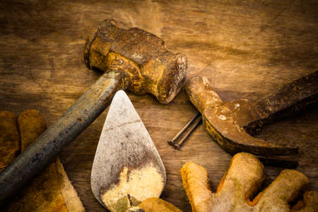work gloves: Still life with dirty tools on hard work Stock Photo