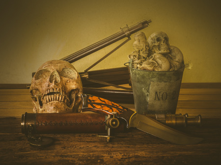 Still life with human skull and vintage binocular on abstract background Stock Photo
